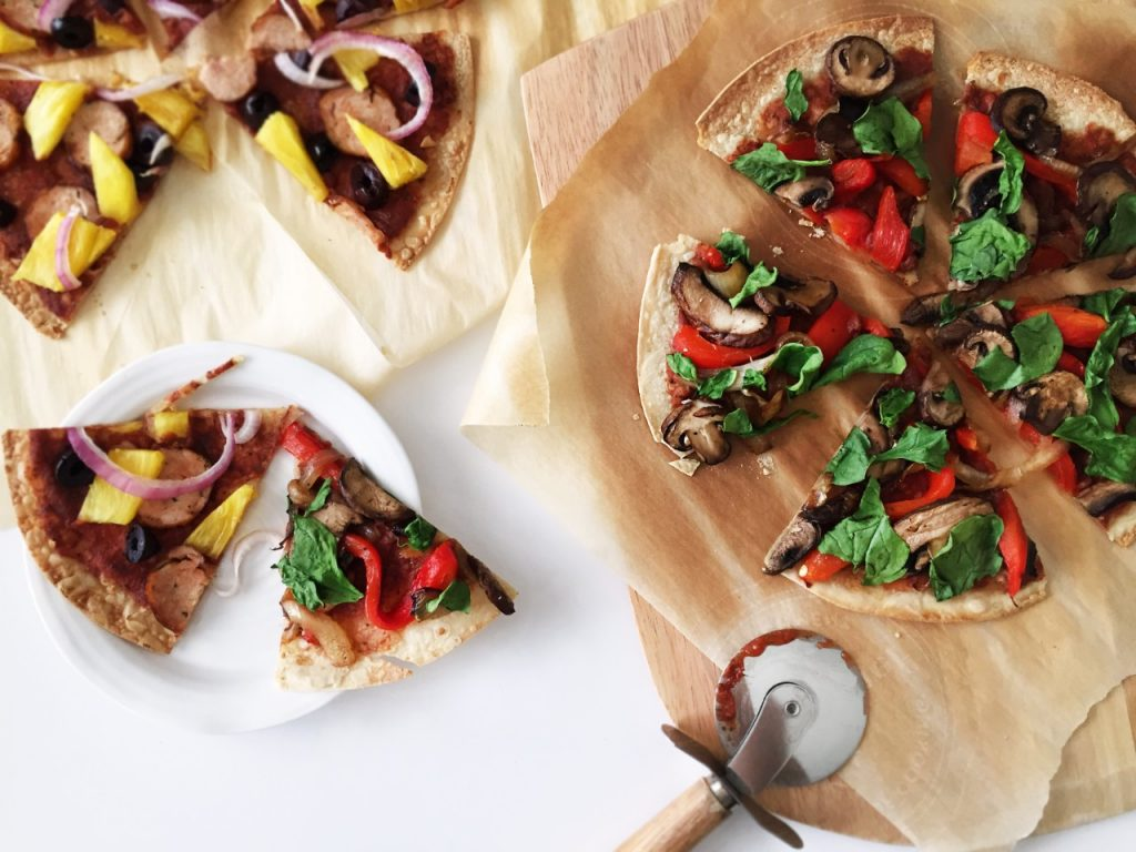 pizza on a board with pizza cutter