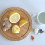 ginger, cut lemon, pinch of cayenne on a cutting board. Cup and spoon with honey off the cutting board
